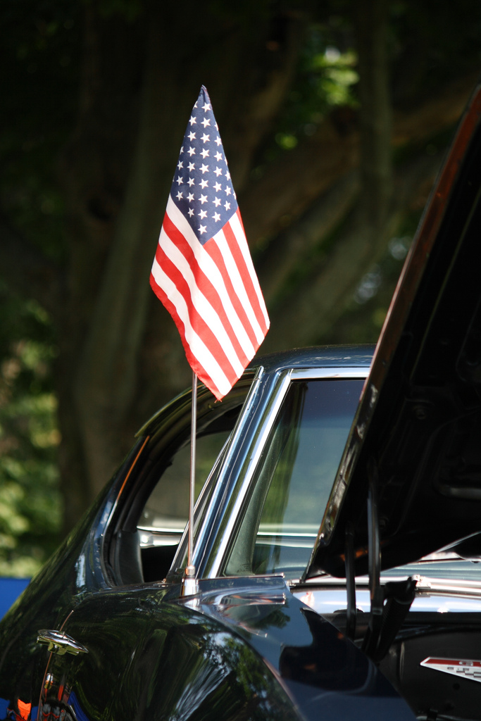 American flag on a classic car.