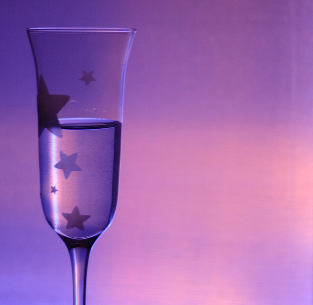 Champagne glass with a purple gel filter and back lighting. Photo by Jenn Dixon.