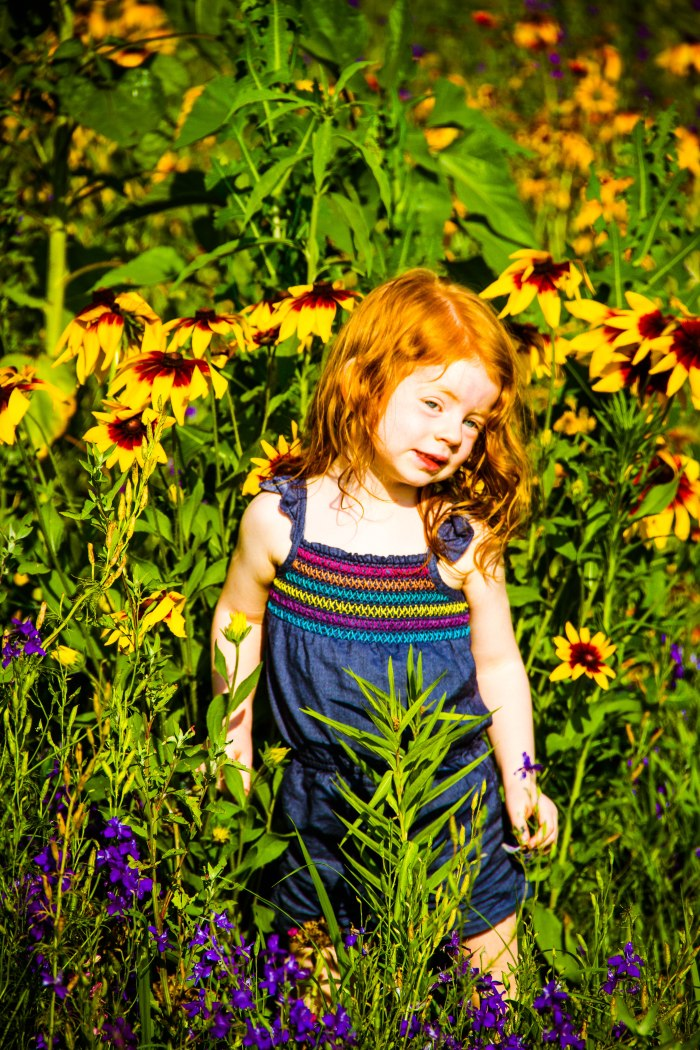 Cutie in the flowers.