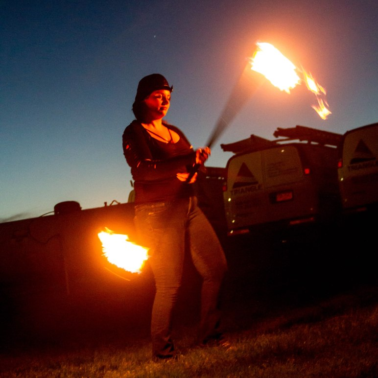 Inger Spins a Fire Staff